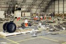 Columbia debris, including landing gear tires, in the RLV Hangar at KSC. NASA photo.